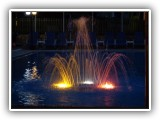 Pool fountain by night